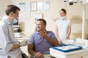 dentist and patient discussing dental insurance
