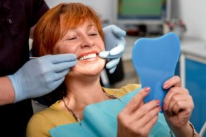 Woman with dental implants in Centerville